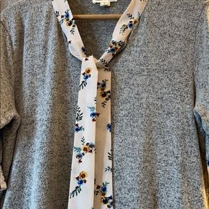 Sweater blouse, worn once.. grey and floral